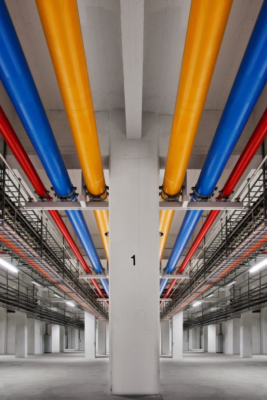 These colorful pipes carry water. Three of our data centers, like this one in Finland, run on 100% unprocessed or greywater. The idea behind this is simple: instead of depending on clean, potable water, we use alternative sources of water and clean it just enough so it can be used for cooling. This water still needs to be processed, but treatment for data center use is much easier than cleaning it for drinking.