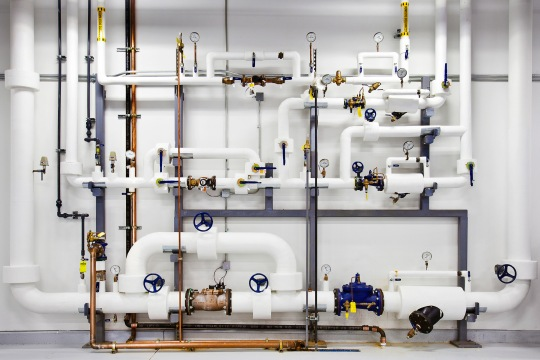 We keep pipes like these ready with highly-pressurized water in case of a fire. This water, in particular, is cleaned and filtered so if we use it, we don't contaminate the facility.